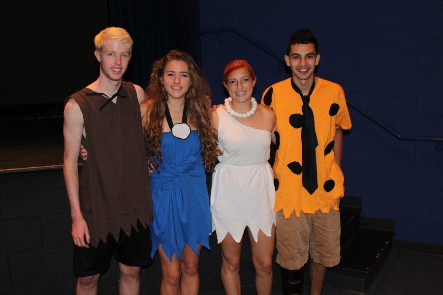 Seniors+Jeffrey+Mangold%2C+Colleen+Heberle%2C+Courtney+Walker%2C+and+Joe+Farran+pose+as+the+Flintstones.