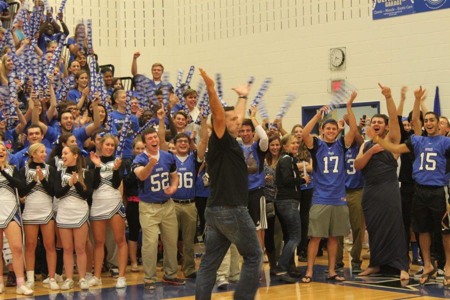Mr.+Burnett+celebrates+winning+the+Oreo+challenge+as+the+crowd+cheers+him+on.