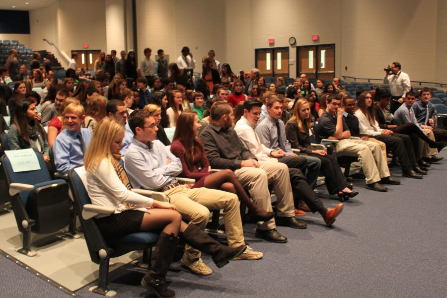 NHS+inductees+sit+in+the+auditorium+during+the+induction+ceremony+on+Monday%2C+November+18th.