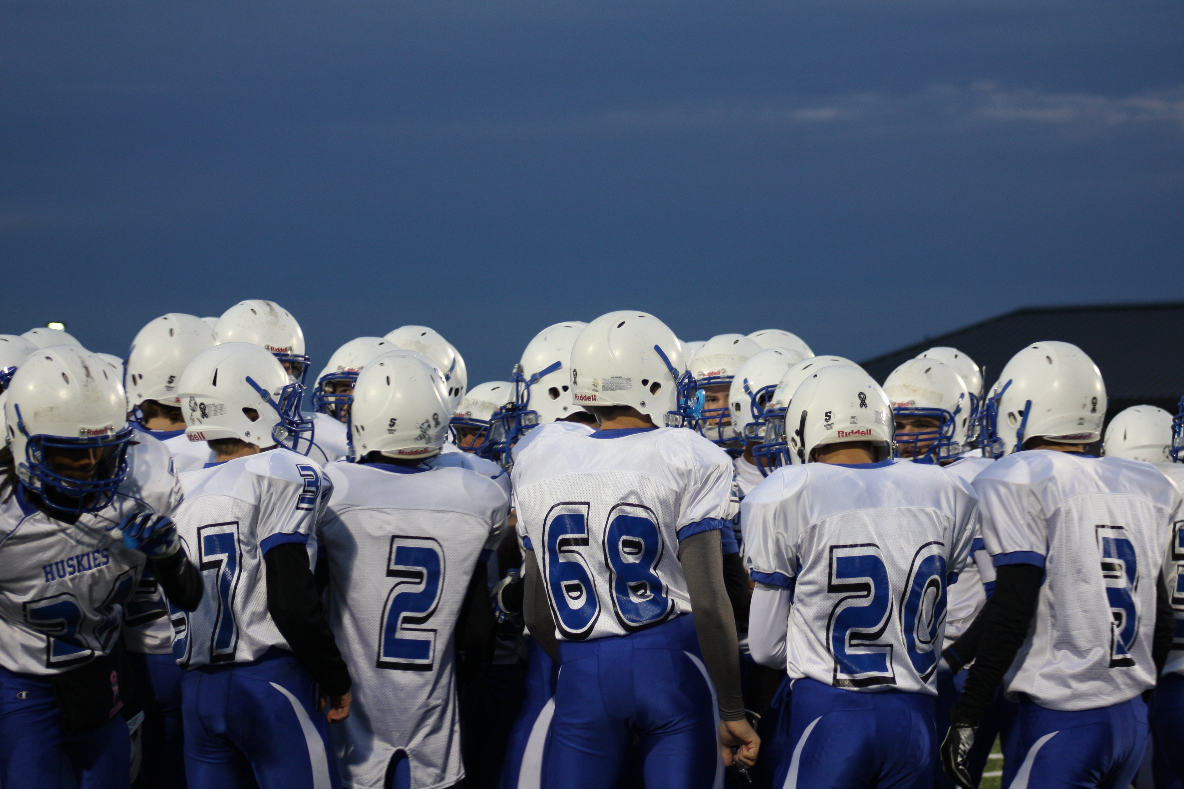 The team huddles up for a pep-talk before the game. Photo credit: Hanna Dunkel