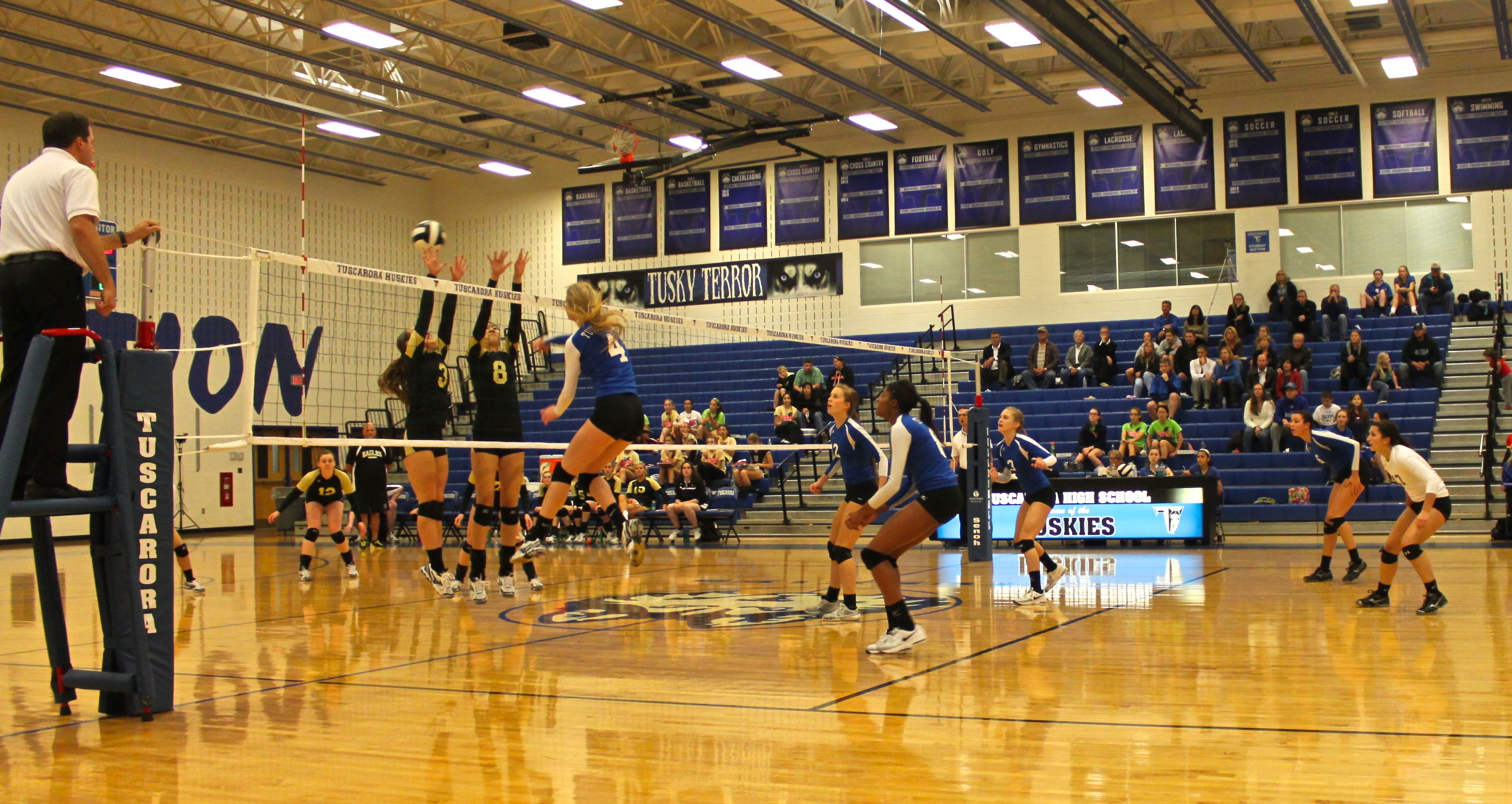 Junior Sydney Garrell delivering a successful spike which led to the 25-15 score in the 2nd Quarter. Photo credit: Rikki Pepino