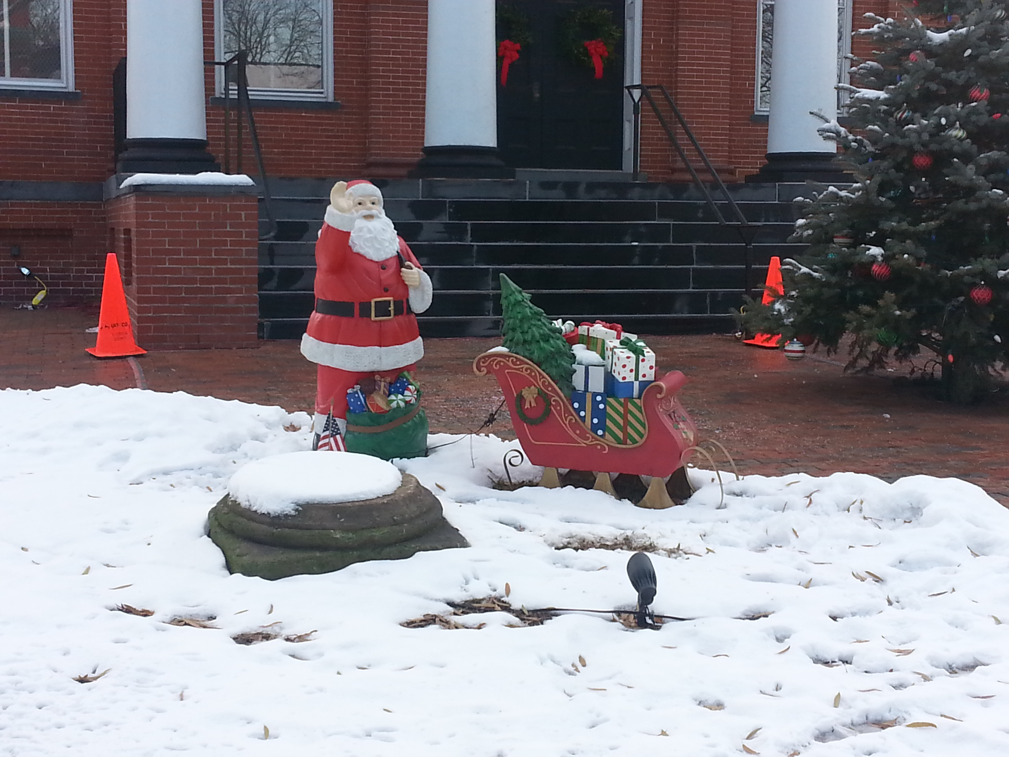 One of the county-sponsored holiday decorations that sits in front of the courthouse includes Santa with his sleigh of presents and a decorated Christmas tree. Photo credit: Jack Minchew