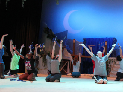 """The ensemble of Once On This Island rehearses the song """"Rain"""" for their upcoming performance on April 3rd, 4th, and 5th. In this scene, the two main characters meet for the first time. Photo credit: Brianna Meeks"""