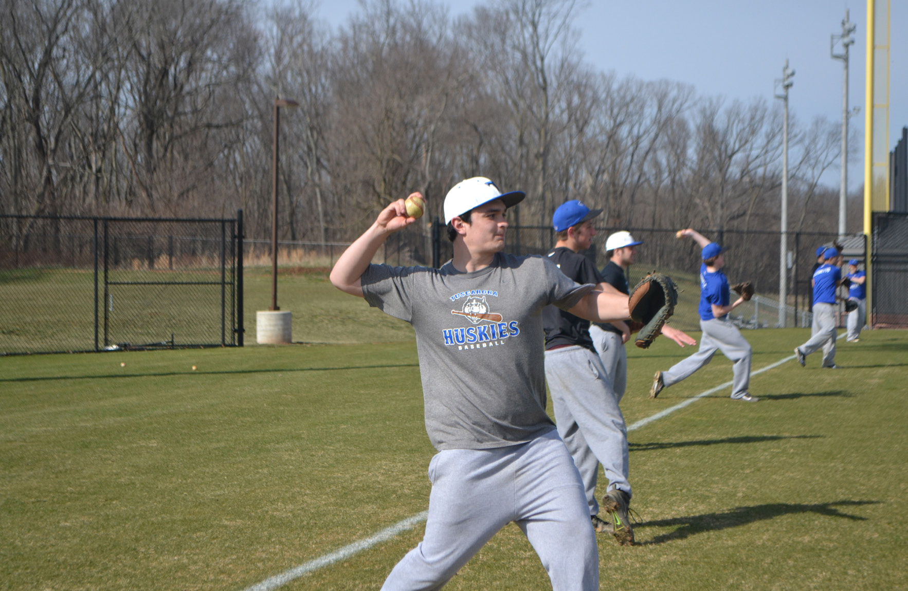 Senior catcher Brady Kaplan throws a pitch as a part of a drill at one of the Tuscarora baseball team's practices. Photo credit: Hanna Duenkel
