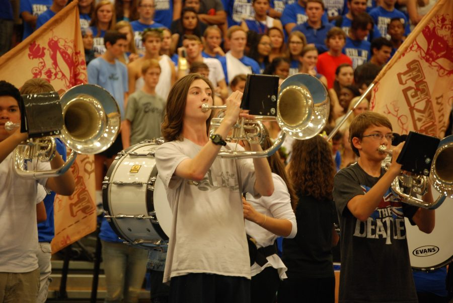 And+the+Trumpets+They+Go-+The+Tuscarora+Marching+Huskies+performed+part+of+their+show+%E2%80%9CBrava%E2%80%9D+along+with+the+color+guard+for+the+students+of+Tuscarora+High+School.+%E2%80%9CBrava%E2%80%9D+is+the+show+that+was+written+by+the+band+director+Katie+Newmiller.+%E2%80%9C...With+all+the+noise+from+the+student+body%2C+it%E2%80%99s+hard+to+tell+how+it+sounds+but+as+far+as+i+could+tell+it+sounded+good%2C%E2%80%9D+said+Alex+Diviney%2C+a+marching+husky+that+plays+bass+drum.+Photo+by%3A+Sara+Koochagian%0A