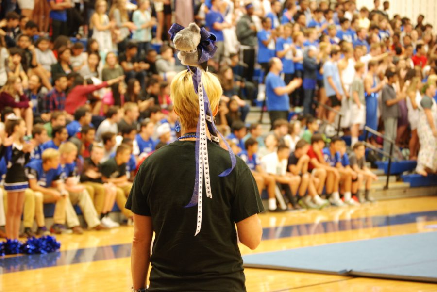 """The Scepter of School Spirit- Ms. Sommer Crawford holds the school spirit stick that would be awarded to the class with the most school spirit. The winner was based on spirit week that students dressed up for and the hallways that were decorated the night before the pep rally. """"I feel like we're finally getting more school spirit. Students know what they're suppose to look like and get excited for them,"""" said Crawford. Photo by: Sara Koochagian"""